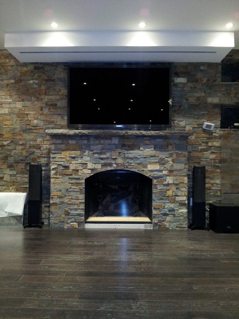 TV Over Fireplace with Drop Down Screen Above