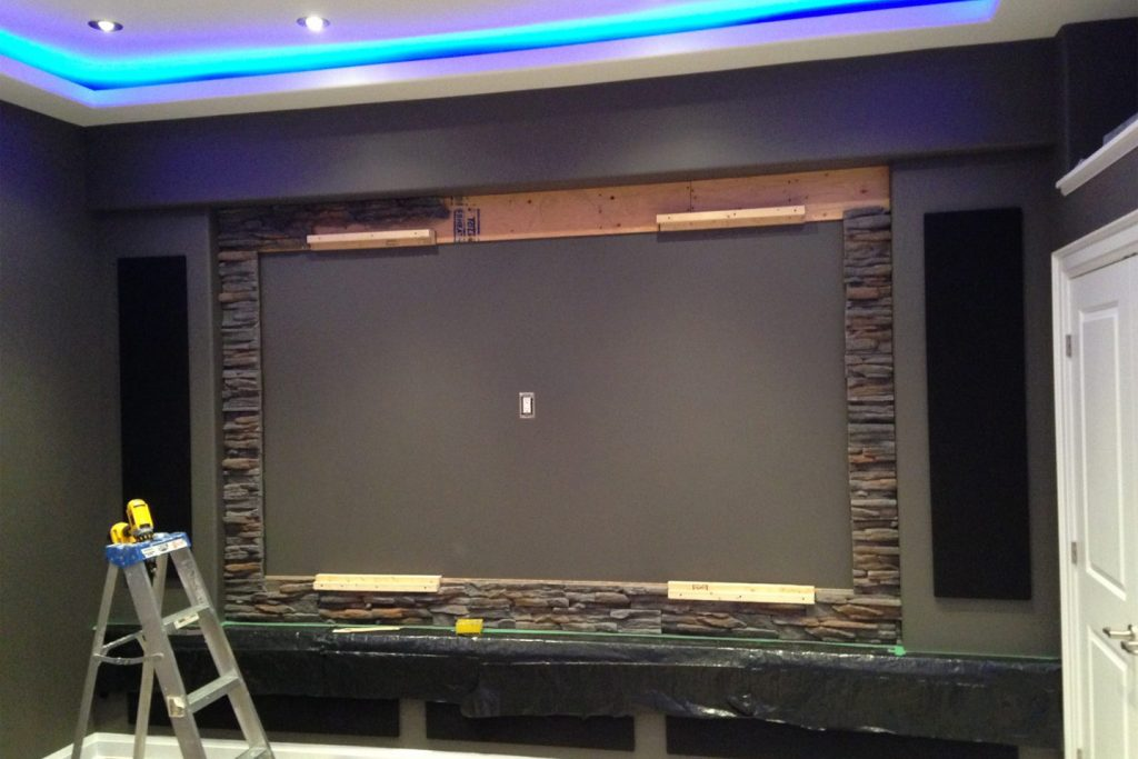 Custom Home Theater Design After Stone Work & Speaker Covers