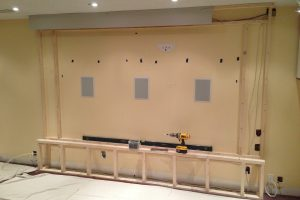 In Wall Speakers and Framing for Perforated Projection Screen Install