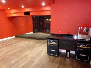 Red Home Theater with Riser and Marshall Fridges