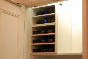 5 Tier Custom Home Audio Shelving in Condominium closet