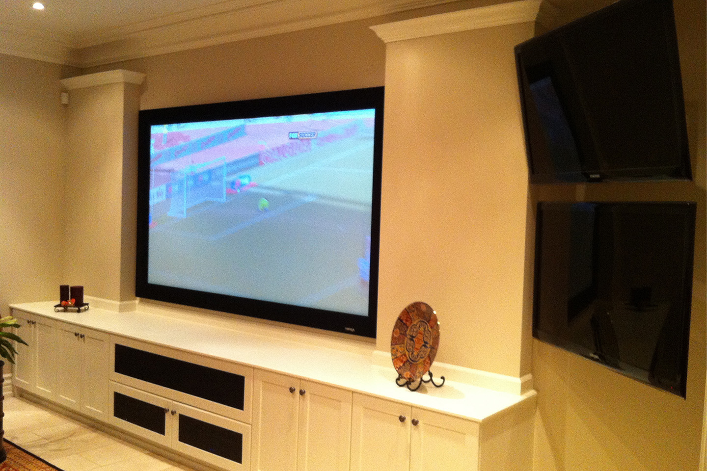 Custom Cabinets & Hidden In-Wall Invisible Speakers