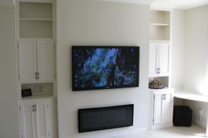 Clean TV Installation with Sub Woofer in Corner