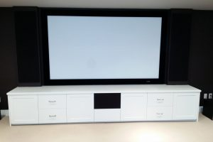 Custom Audio Furniture below 106 inch projection screen with custom cabinet and hidden speakers