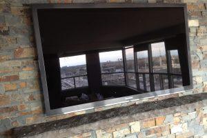 TV Above Fireplace on Slate Finished Wall
