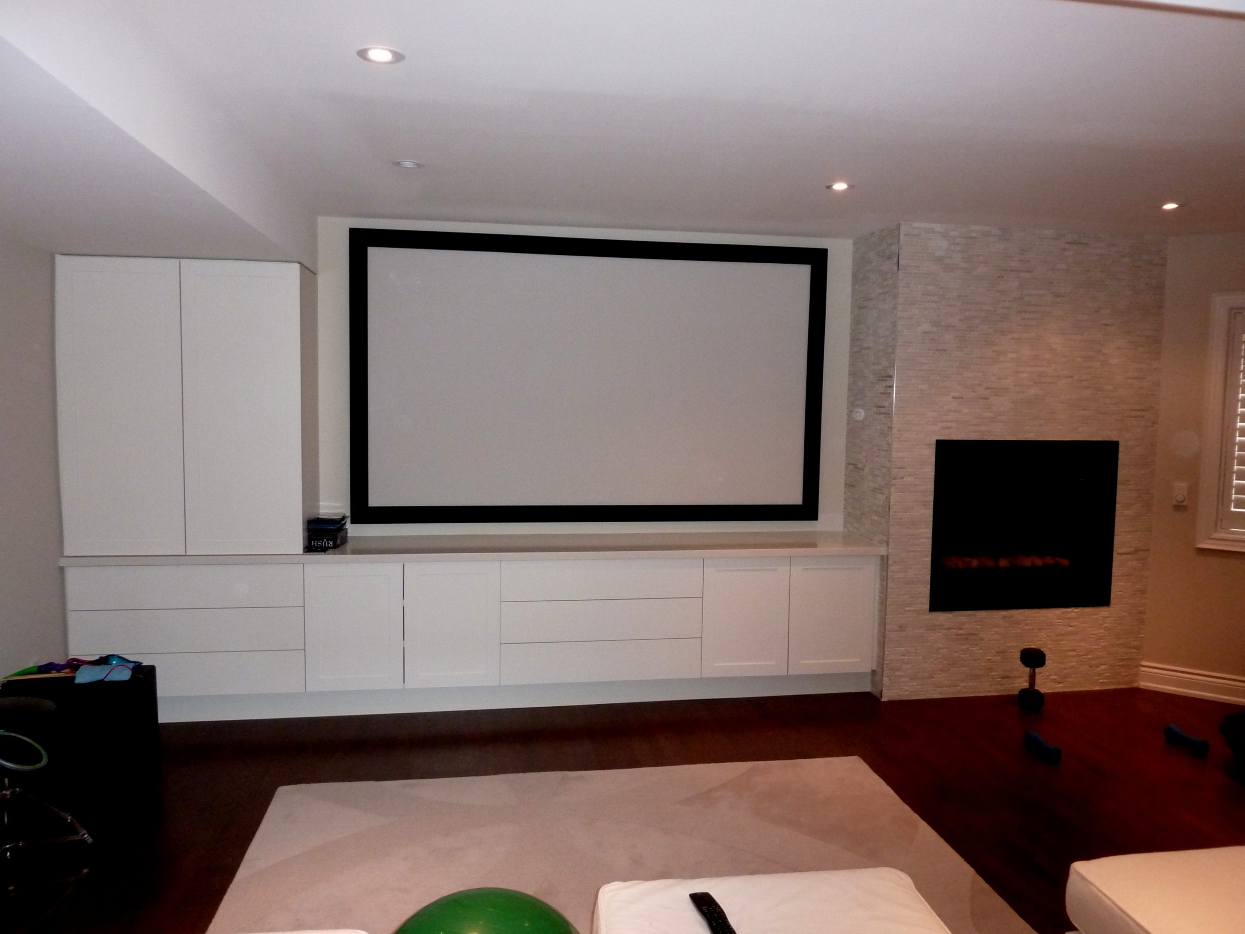 Perforated Projection Screen with Speakers in Behind and Custom Cabinets with Hidden Equipment