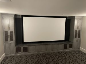 Large Projection Screen Surrounded by Custom Audio Cabinets