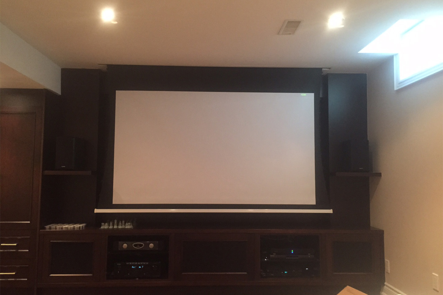 4. Projection Screen Drops Down in Front of TV